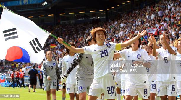 Hye Ri Kim of South Korea celebrate with her team mates after winning the 2010 FIFA Women's World Cup third place match between South Korea and...