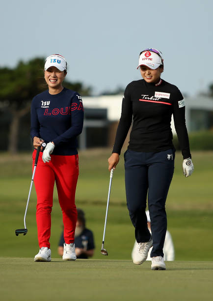 Hyejin Choi of South Korea and Heeyoung Park of South Korea walk onto the 18th Beach Course hole during their 4th hole playoff on Day Four of the...