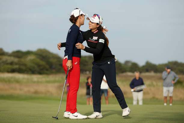 Hyejin Choi of South Korea hugs Heeyoung Park of South Korea after their 4th hole playoff on Day Four of the ISPS Handa Vic Open at 13th Beach Golf...