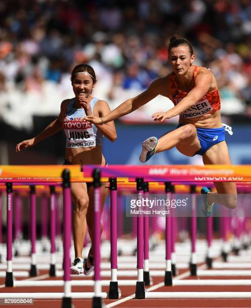 Hyelim Jung of Korea and Nadine Visser of the Netherlands compete in the Women's 100 metres hurdles heats during day eight of the 16th IAAF World...