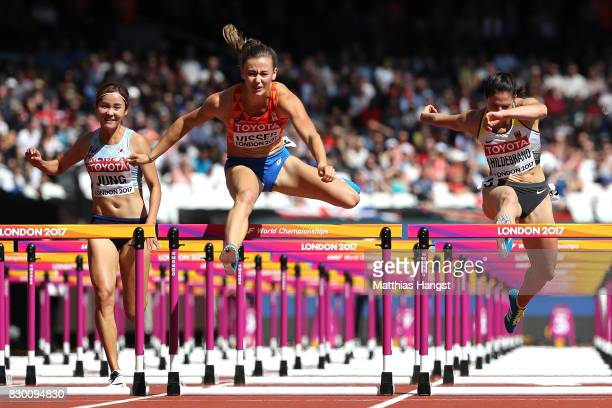 Hyelim Jung of Korea Nadine Visser of the Netherlands and Nadine Hildebrand of Germany compete in the Women's 100 metres hurdles heats during day...