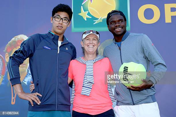 Hyeon Chung of Korea and Frances Tiafoe pose with Jane Pearcy Berlingame during the men's draw for the BNP Paribas Open at the Indian Wells Tennis...