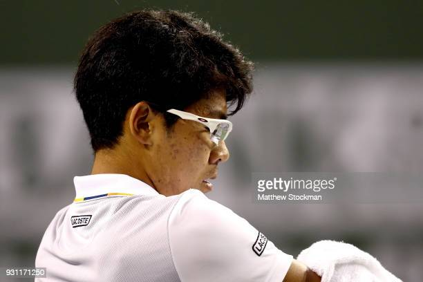 Hyeon Chung of Korea cools down between games while playing Tomas Berdych of Czech Republic during the BNP Paribas Open at the Indian Wells Tennis...