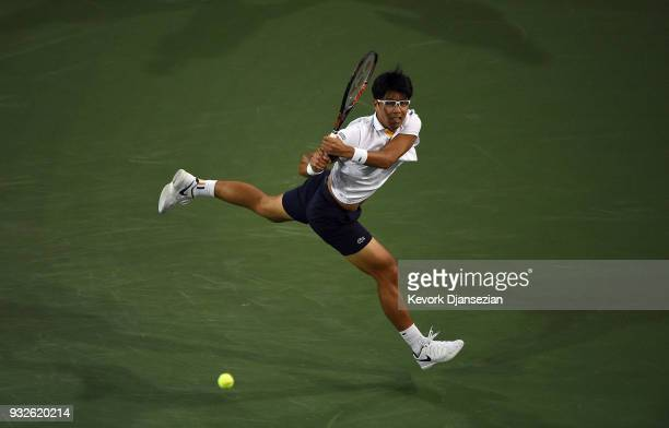 Hyeon Chung of Korea hits a running backhand against Roger Federer Switzerland during Day 11 of BNP Paribas Open on March 15 2018 in Indian Wells...