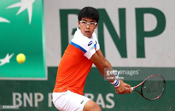 Hyeon Chung of Korea plays a backhand during the Men's Singles first round match against Quentin Halys of France on day three of the 2016 French Open...