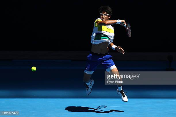 Hyeon Chung of Korea plays a forehand in his second round match against Grigor Dimitrov of Bulgaria on day four of the 2017 Australian Open at...