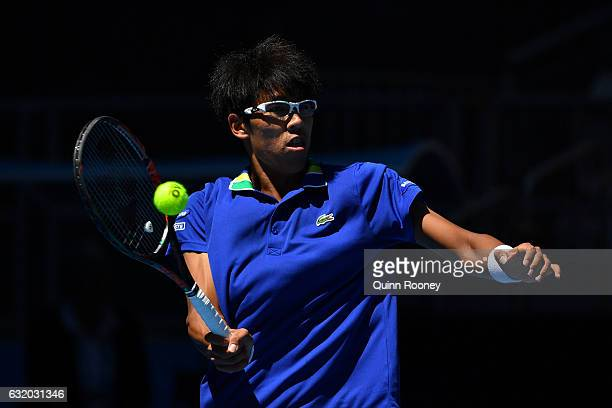 Hyeon Chung of Korea polays a forehand in his second round match against Grigor Dimitrov of Bulgaria on day four of the 2017 Australian Open at...