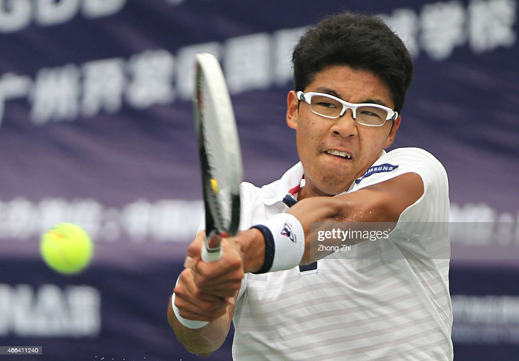 Hyeon Chung of Korea returns a shot during his match against Roberto Carballes Baena of Spain during the ATP Challenger Guangzhou Tour Day 5 at Guangzhou Development District International Tennis School on March 14, 2015 in Guangzhou, China.