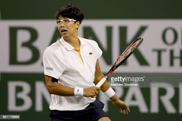Hyeon Chung of Korea returns a shot to Tomas Berdych of Czech Republic during the BNP Paribas Open at the Indian Wells Tennis Garden on March 12 2018...