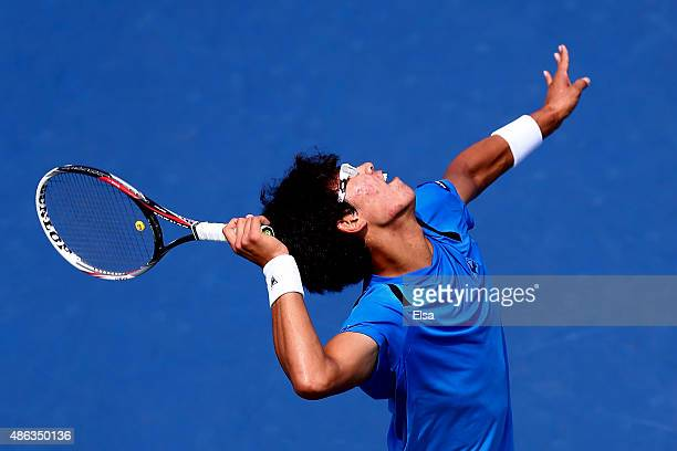 Hyeon Chung of Korea serves against Stan Wawrinka of Switzerland during their Men's Singles Second Round match on Day Four of the 2015 US Open at the...