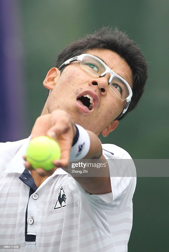 Hyeon Chung of Korea serves during his match against Roberto Carballes Baena of Spain during the ATP Challenger Guangzhou Tour Day 5 at Guangzhou Development District International Tennis School on March 14, 2015 in Guangzhou, China.