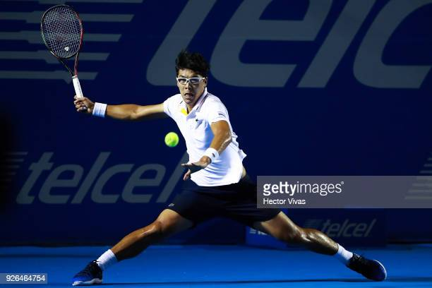 Hyeon Chung of Korea takes a forehand shot during the match between Hyeon Chung of Korea and Kevin Anderson of South Africa as part of the Telcel ATP...