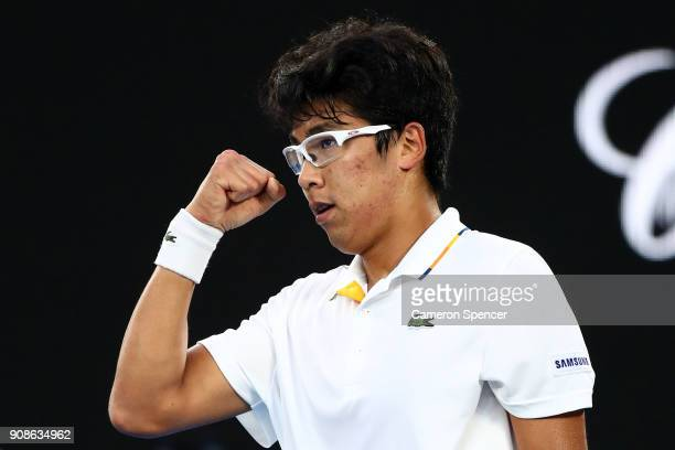 Hyeon Chung of South Korea celebrates winning the first set in his fourth round match against Novak Djokovic of Serbia on day eight of the 2018...