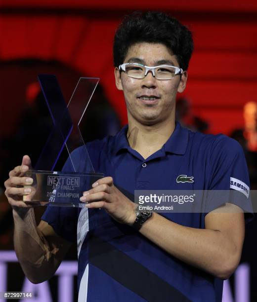 Hyeon Chung of South Korea celebrates with the trophy after victory against Andrey Rublev of Russia in the mens final on day 5 of the Next Gen ATP...