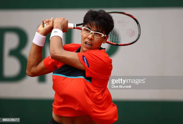 Hyeon Chung of South Korea hits a backhand during the first round match against Sam Querrey of The USA on day three of the 2017 French Open at Roland...