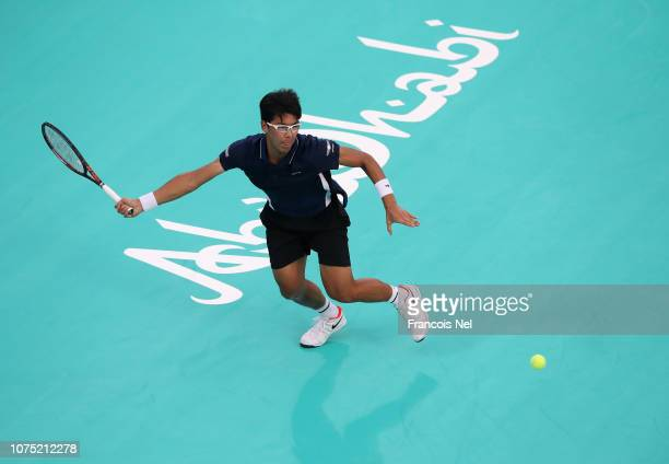 Hyeon Chung of South Korea in action against Kevin Anderson of South Africa during his men's singles match on day one of the Mubadala World Tennis...