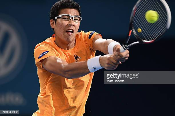 Hyeon Chung of South Korea plays a backhand against Sam Groth of Australia during day two of the 2016 Brisbane International at Pat Rafter Arena on...