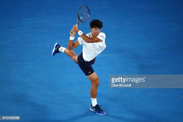 Hyeon Chung of South Korea plays a backhand in his semifinal match against Roger Federer of Switzerland on day 12 of the 2018 Australian Open at...