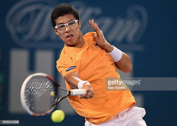 Hyeon Chung of South Korea plays a forehand against Sam Groth of Australia during day two of the 2016 Brisbane International at Pat Rafter Arena on...