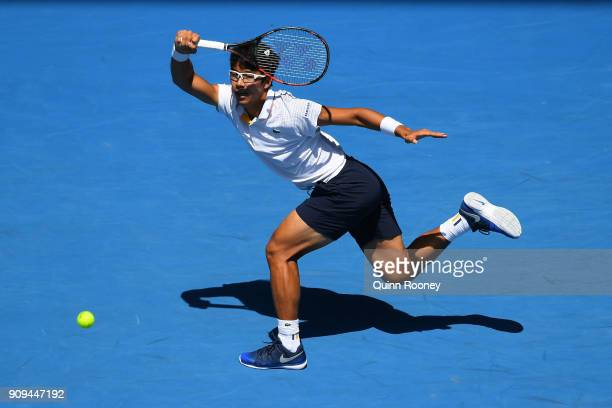 Hyeon Chung of South Korea plays a forehand in his quarterfinal match against Tennys Sandgren of the United States on day 10 of the 2018 Australian...