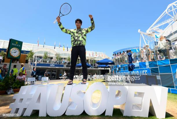 Hyeon Chung of South Korea poses on the AusOpen hashtag on day 11 of the 2018 Australian Open at Melbourne Park on January 23, 2018 in Melbourne,...