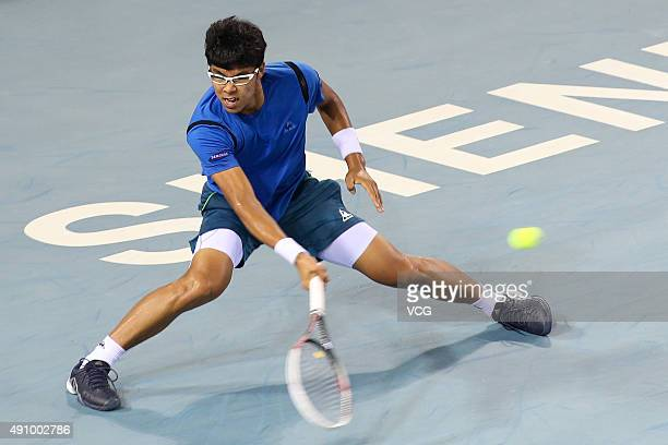 Hyeon Chung of South Korea returns a shot against Marin Cilic of Croatia in quarterfinal match during day five of the 2015 Shenzhen Open ATP World...