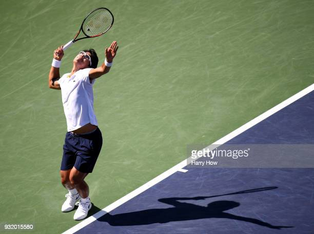 Hyeon Chung of South Korea serves in his match against Pablo Cuevas of Uruguay during the BNP Paribas Open at the Indian Wells Tennis Garden on March...