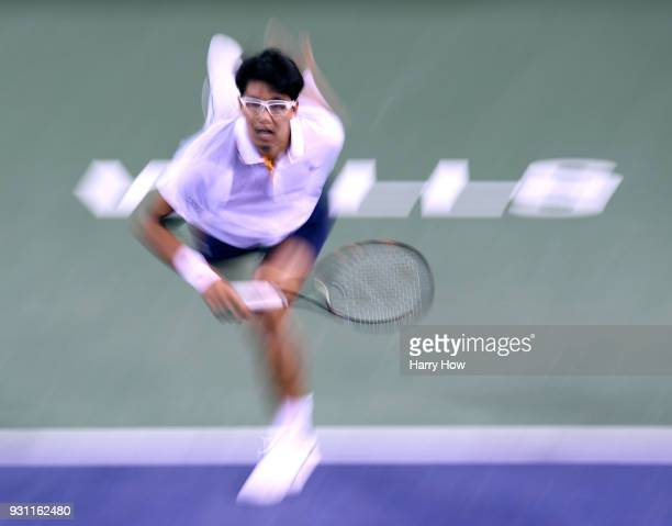Hyeon Chung of South Korea serves in his match against Tomas Berdych of the Czech Republic during the BNP Paribas Open at the Indian Wells Tennis...