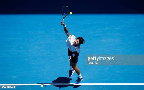 Hyeon Chung of South Korea serves in his quarterfinal match against Tennys Sandgren of the United States on day 10 of the 2018 Australian Open at...