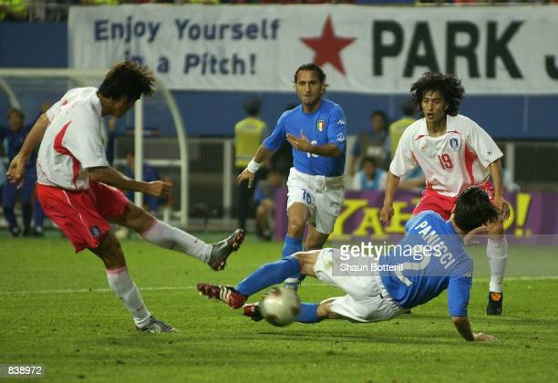 Hyeon Ki Seol of South Korea shoots past Christian Panucci of Italy to score a late equaliser during the FIFA World Cup Finals 2002 Second Round...