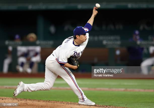 Hyeon-Jong Yang of the Texas Rangers throws against the Los Angeles Angels in the sixth inning at Globe Life Field on April 26, 2021 in Arlington,...