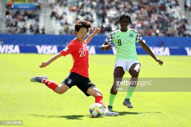 Hyeri Kim of Korea Republic shoots under pressure from Asisat Oshoala of Nigeria during the 2019 FIFA Women's World Cup France group A match between...