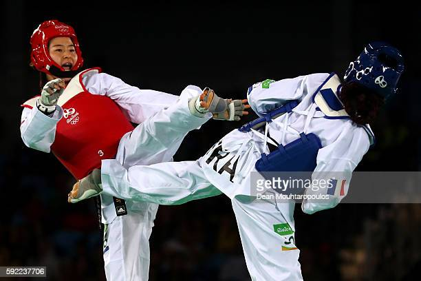 Hyeri Oh of South Korea competes against Haby Niare of France in the Women's Taekwondo 67kg Gold Medal Contest on Day 14 of the Rio 2016 Olympic...