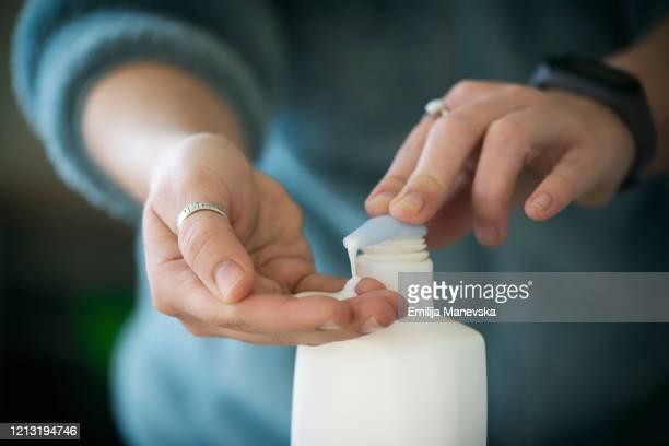 hygiene hand disinfection - handcrème stockfoto's en -beelden