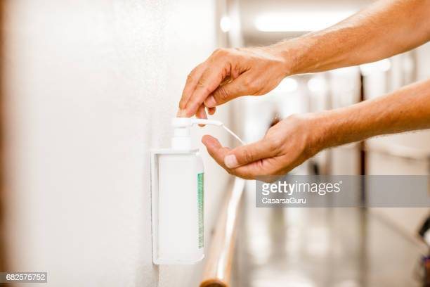 hygiene hand disinfection - disinfection stock pictures, royalty-free photos & images