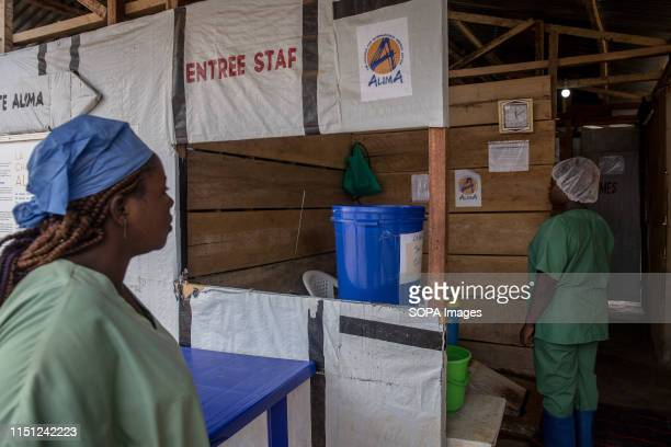 Hygienists seen at the entrance of the Ebola treatment centre in Beni eastern Democratic Republic of the Congo The DRC is currently experiencing the...