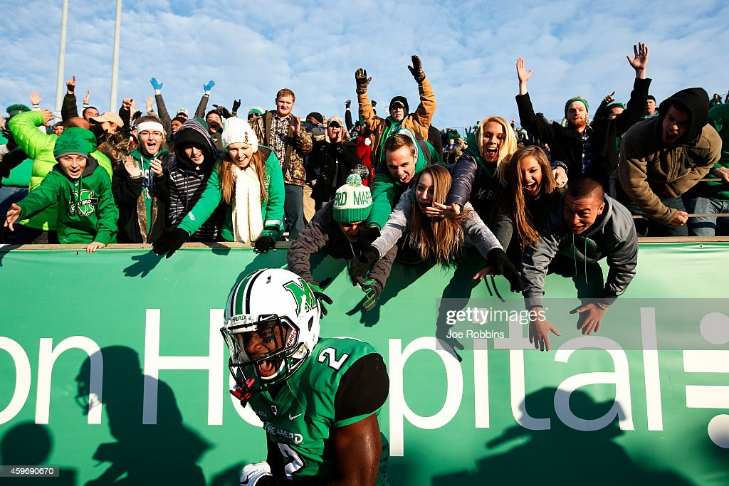 Hyleck Foster #2 of the Marshall Thundering Herd celebrates with fans after a 25-yard touchdown in overtime against the Western Kentucky Hilltoppers at Joan C. Edwards Stadium on November 28, 2014 in Huntington, West Virginia. Western Kentucky defeated Marshall 67-66 on a two-point conversion in overtime to hand them their first loss of the season.