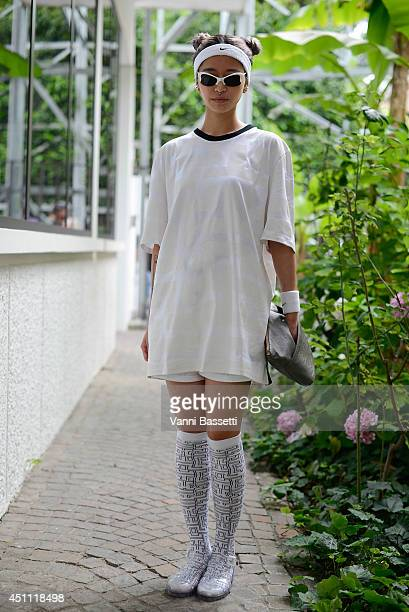 Hym Lee is seen wearing a Labyrinth shirt and socks and Nike headband before Dirk Bikkembergs show on June 23 2014 in Milan Italy