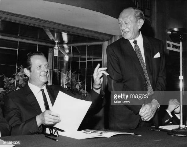 Hyman Kreitman managing director of Tesco Stores Ltd laughing with Sir John Edward 'Jack' Cohen chairman of Tesco during the Annual General Meeting...