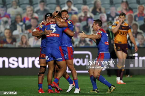 Hymel Hunt of the Knights celebrates with team mates after scoring a try during the round six NRL match between the Newcastle Knights and the...