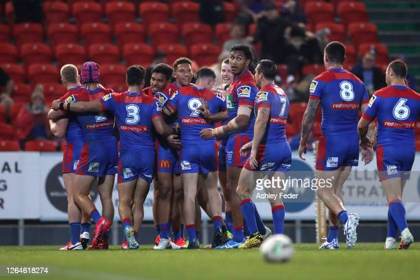 Hymel Hunt of the Newcastle Knights celebrates his try with team mates during the round 13 NRL match between the Newcastle Knights and the Wests...