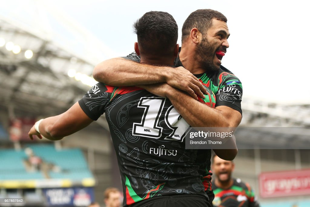 Hymel Hunt of the Rabbitohs celebrates with team mate Greg Inglis of the Rabbitohs after scoring a try during the round 10 NRL match between the South Sydney Rabbitohs and the St George Illawarra Dragons at ANZ Stadium on May 13, 2018 in Sydney, Australia.