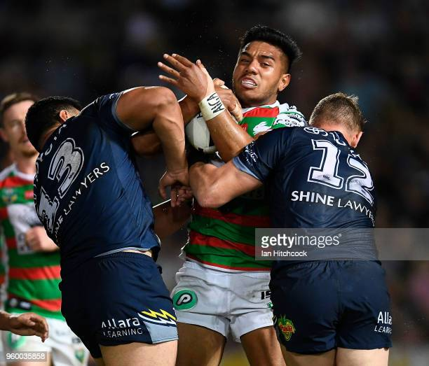 Hymel Hunt of the Rabbitohs is tackled by Coen Hess and Jason Taumalolo of the Cowboys during the round 11 NRL match between the North Queensland...