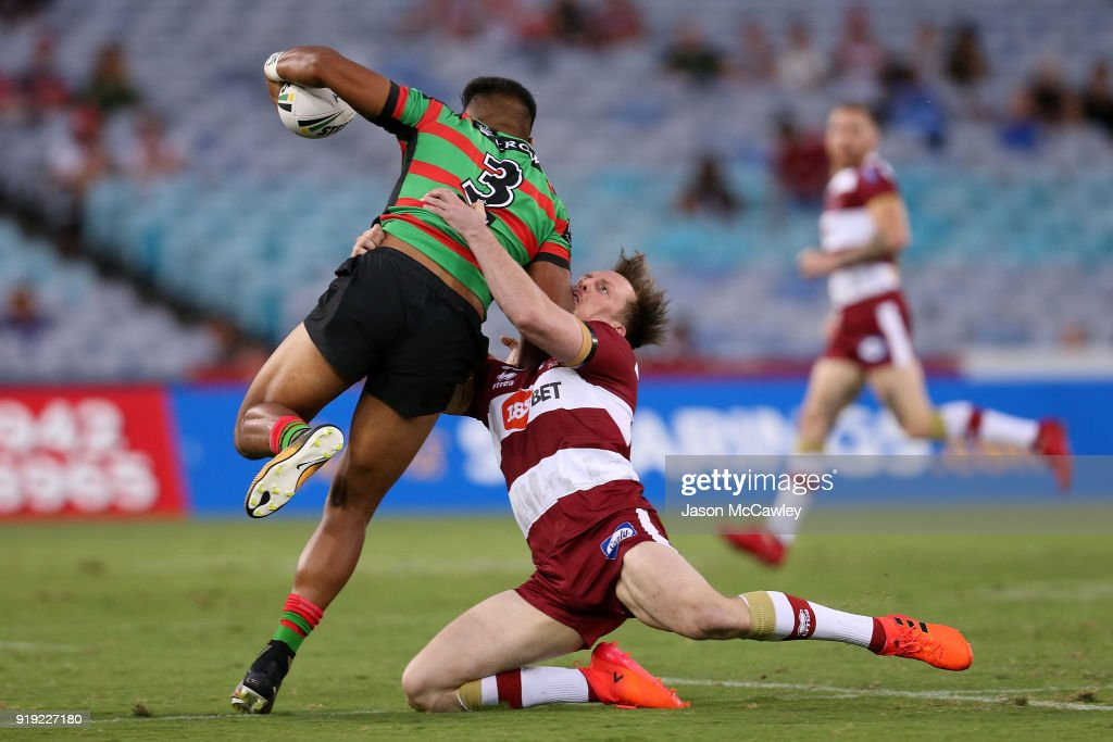 Hymel Hunt of the Rabbitohs is tackled by Dan Sarginson of Wigan during the NRL trial match between the South Sydney Rabbitohs and Wigan at ANZ Stadium on February 17, 2018 in Sydney, Australia.