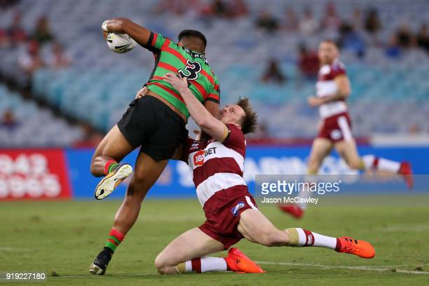 Hymel Hunt of the Rabbitohs is tackled by Dan Sarginson of Wigan during the NRL trial match between the South Sydney Rabbitohs and Wigan at ANZ...