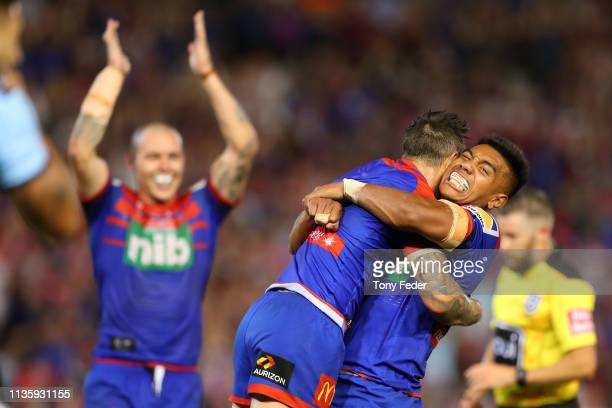 Hymel Huntof the Newcastle Knights celebrates with team mate Mitchell Pearce during round one NRL match between the Newcastle Knights and the...