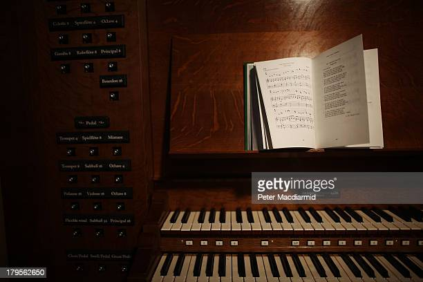 A hymn books sits open on the organ console at St George's Church on February 15 2012 in London England The new organ 'Opus XVIII' is being built and...