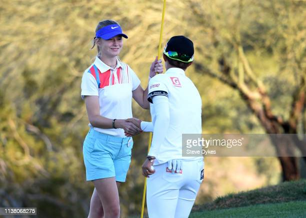 Hyo Joo Kim of Korea shakes the hand of amember of the LPGAUSGA Girls Golf of Phoenix holds a some flowers to be presented to the winner of the Bank...