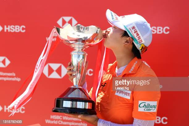 Hyo Joo Kim of South Korea kisses the trophy after winning the tournament following the final round of the HSBC Women's World Championship at Sentosa...