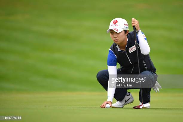 Hyo Joo Kim of South Korea lines up her putt on the 13th green during day 4 of the Evian Championship at Evian Resort Golf Club on July 28 2019 in...